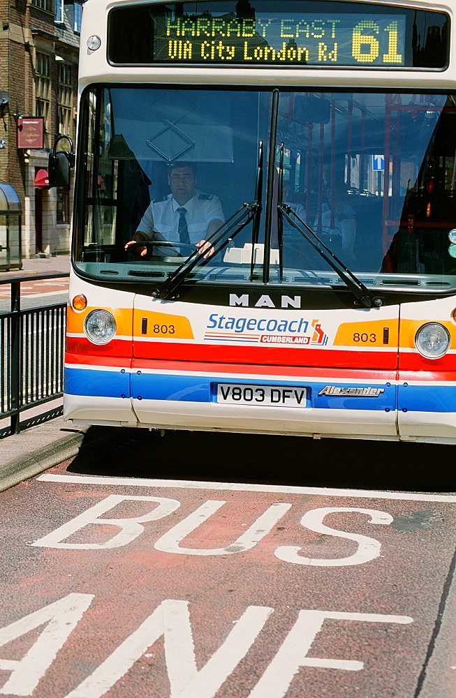 Bus in a bus lane in Carlisle, Cumbria, England, United Kingdom, Europe