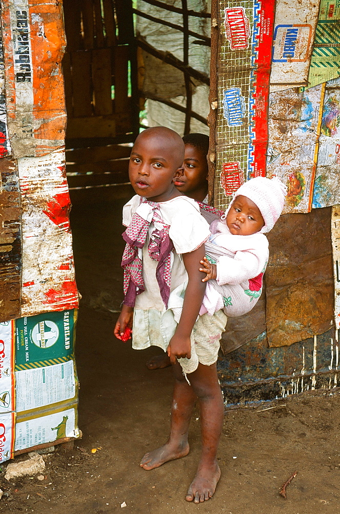 An African child carrying a baby in Mombasa, Kenya, East Africa, Africa
