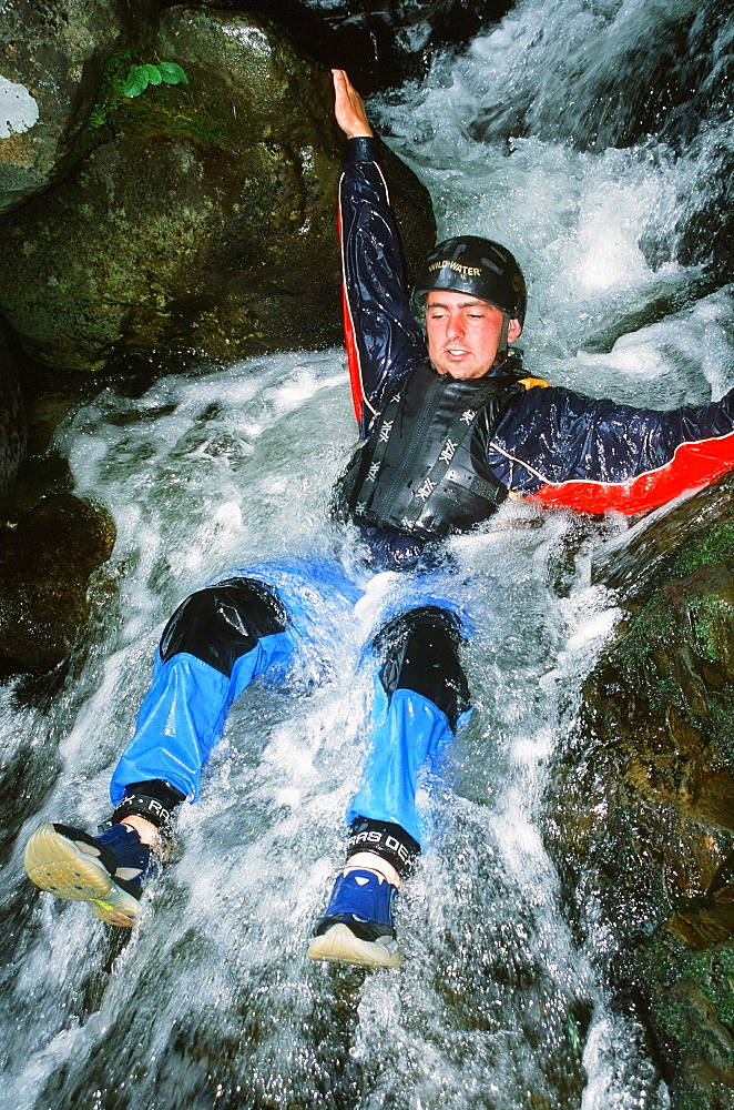 A man canyoning in mid Wales, United Kingdom, Europe