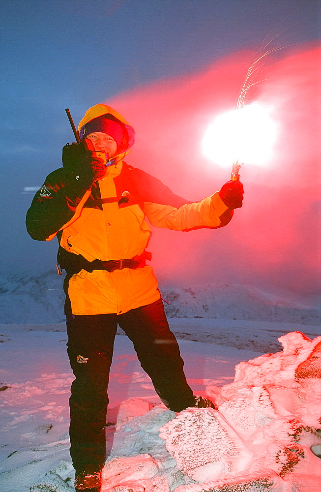 A member of Langdale Ambleside mountain Rescue Team with a flare on the radio, Lake District, Cumbria, England, United Kingdom, Europe