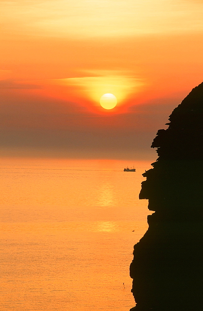 Fishing boat off St. Bees Head at sunset, West Cumbria, England, United Kingdom, Europe