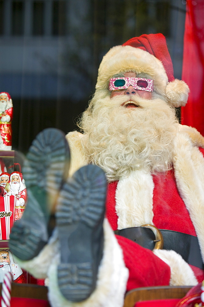 Father Christmas in a window display in a department store on Oxford Street in London, England, United Kingdom, Europe