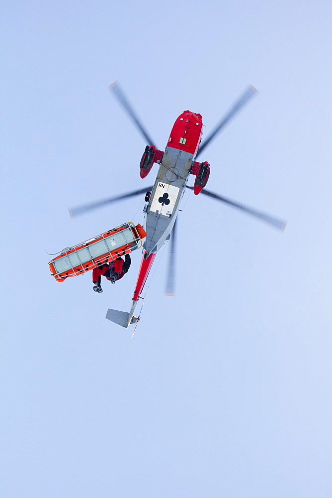 A Navy Sea King evacuates a seriously injured walker who had fallen 250 feet on Bow Fell in the Lake District, Cumbria, England, United Kingdom, Europe