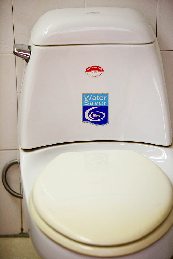 A save water sticker on a Chinese toilet in a hotel in Harbin, Heilongjiang, China, Asia
