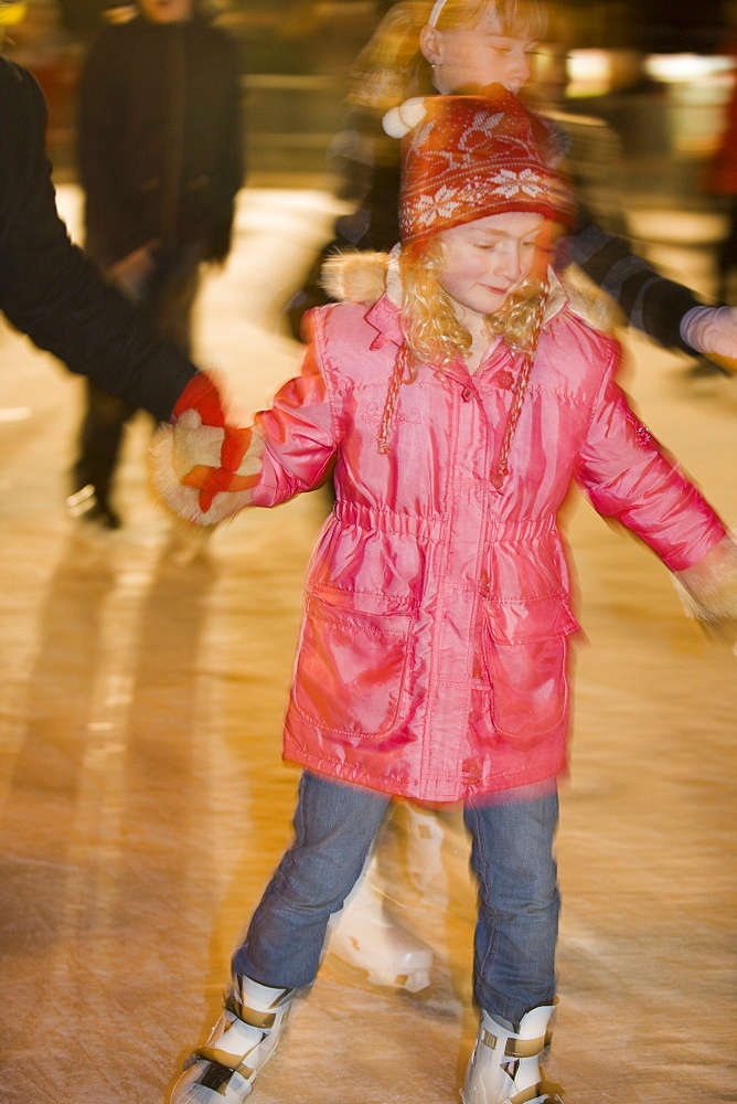 A young girl skating on an artificial ice rink in Lincoln city centre, Lincoln, Lincolnshire, England, United Kingdom, Europe
