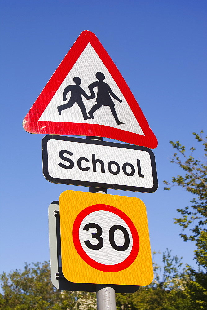 A school sign and speed limit sign in Berrynarbor, Devon, England, United Kingdom, Europe