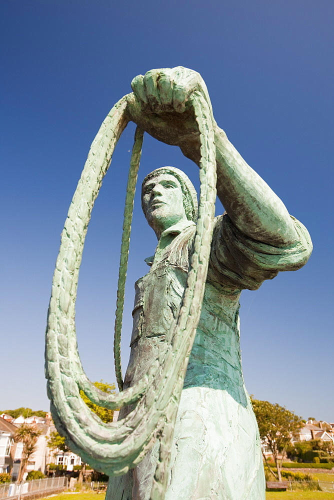A statue of a young fisherman by local artist Tom Leaper in Newlyn, a memorial to fishermen lost at sea, Cornwall, England, United Kingdom, Europe