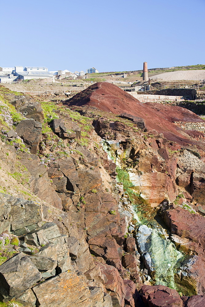 Sea Cliffs stained green from copper deposits leaching from the old Geevor Tin Mine near St Just in Cornwall,, United Kingdom
