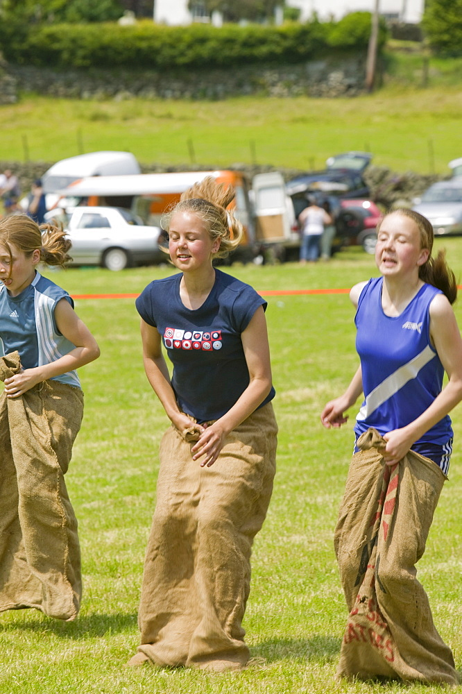 A sack race at the Langdale Gala, Lake District, Cumbria, England, United Kingdom, Europe