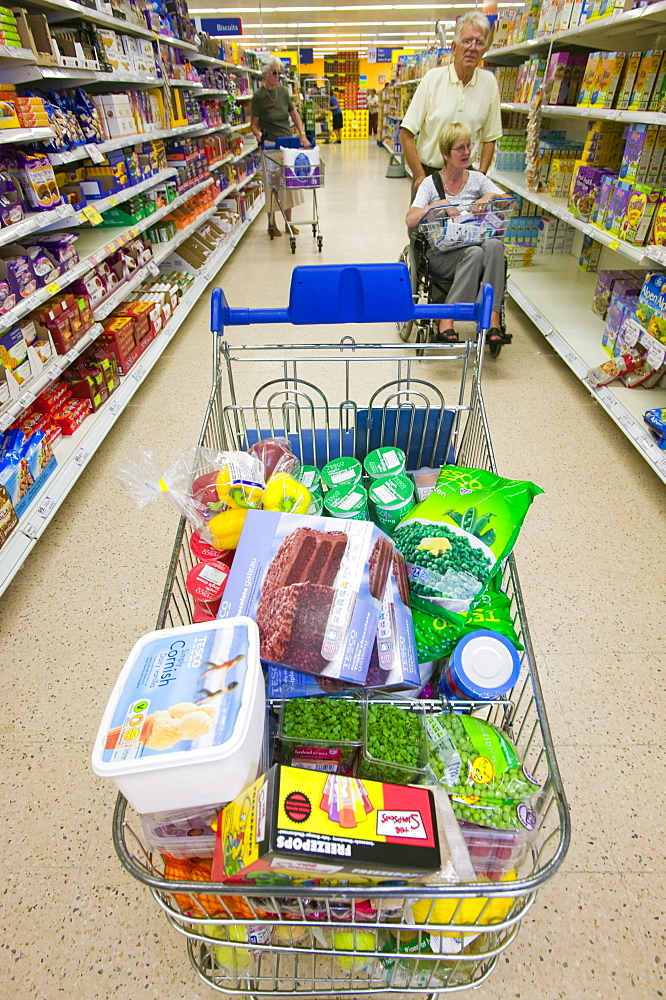 A full trolley of food shopping in a supermarket, Cumbria, England, United Kingdom, Europe