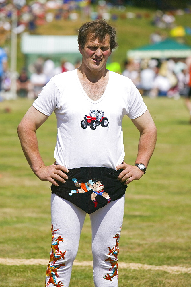 A Cumberland wrestler wearing traditional costume at Ambleside Sports, Lake District, Cumbria, England, United Kingdom, Europe