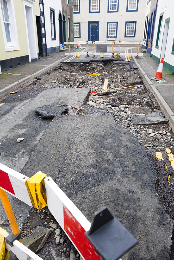 Gas main pipes revealed as the water ripped the tarmac off the road during the floods in November 2009, Cockermouth, Cumbria, England, United Kingdom, Europe