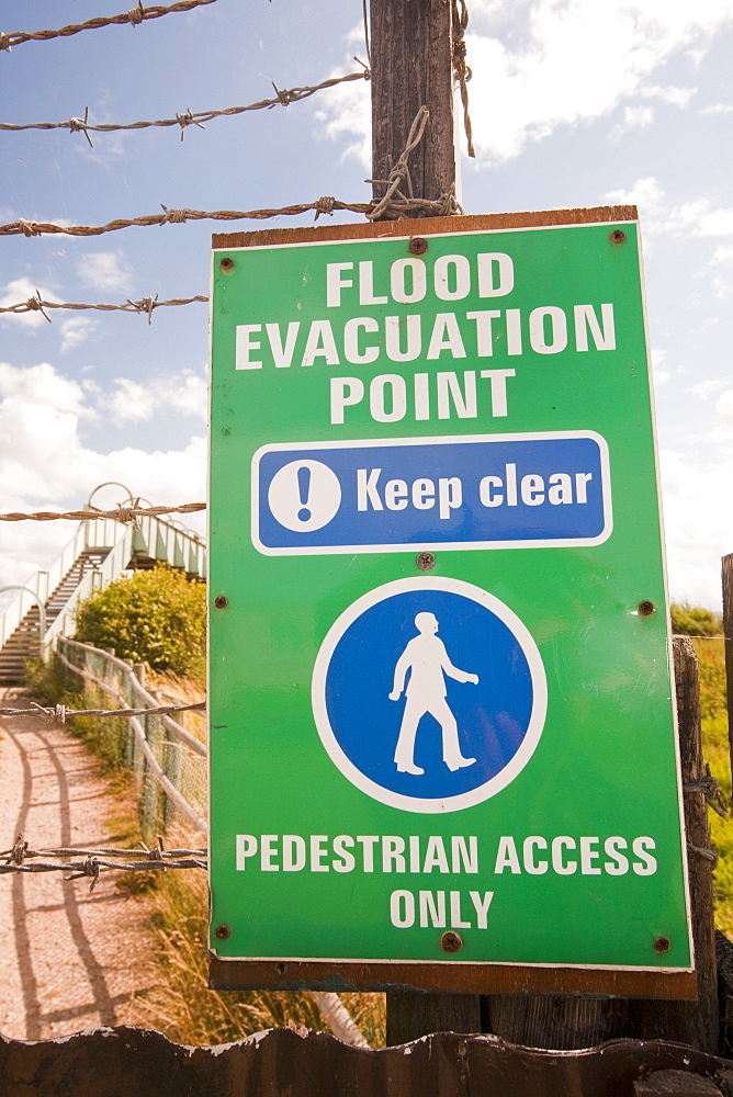 A flood evacuation sign in a caravan park in Kinmel bay that is susceptible to coastal flooding, Wales, United Kingdom, Europe