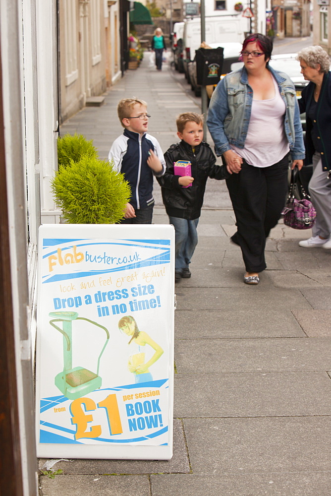 An advert for flab buster outside a shop in Clitheroe, Lancashire, England, United Kingdom, Europe