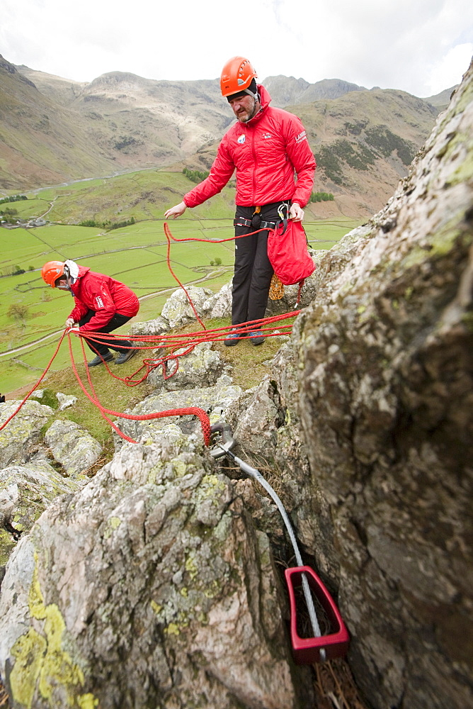 Members of the Langdale Ambleside Mountain Rescue setting up belays on a Team training in the Langdale Valley, Lake District, Cumbria, England, United Kingdom, Europe