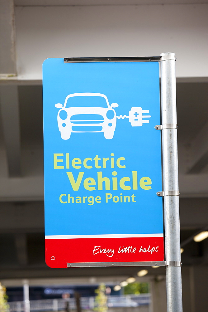 An electric car charging point provided free of charge in a Tesco Supermarket car park for their customers, near Earls Court, London, England, United Kingdom, Europe