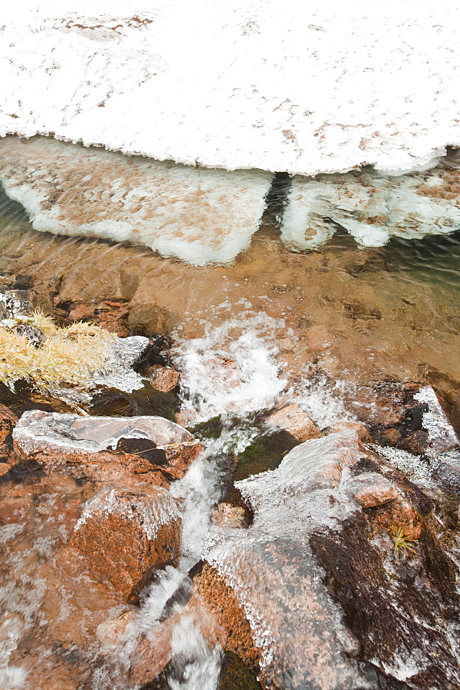 Avalanche debris and ice breaking up on Coire an Lochain, Cairngorms, Scotland, United Kingdom, Europe