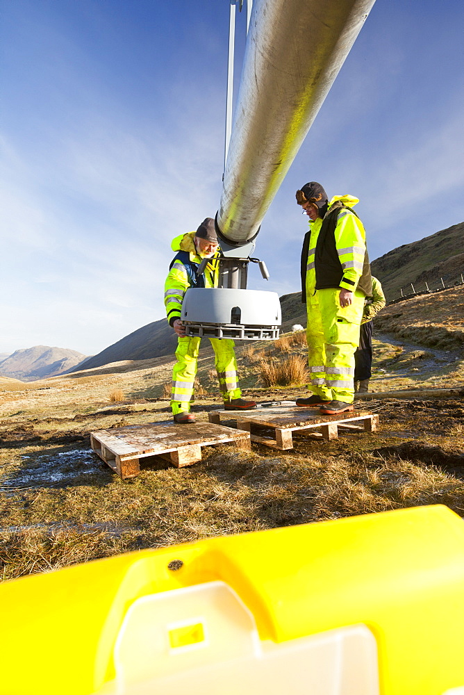 Three wind turbines being constructed behind the Kirkstone Pass Inn on Kirkstone Pass in the Lake District, Cumbria, England, United Kingdom, Europe - 911-7914