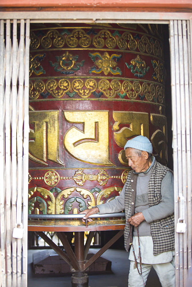 Prayer wheel at the Boudhanath Stupa, one of the holiest Buddhist sites in Kathmandu, Nepal, Asia