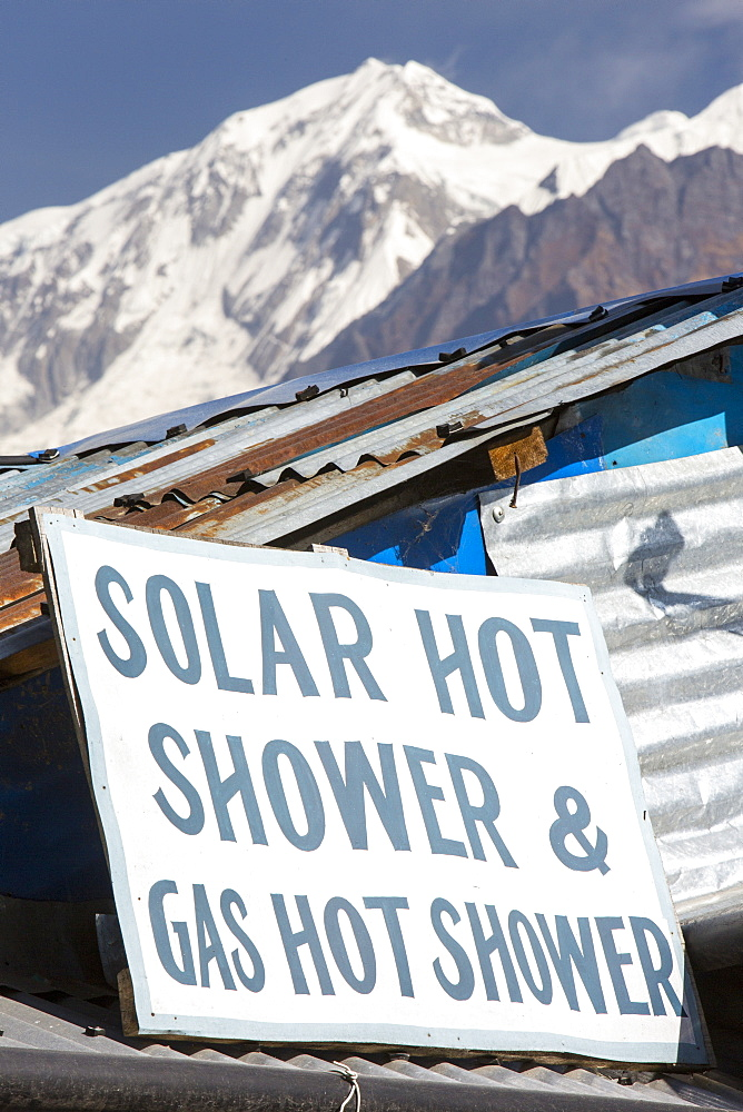 A tea house advertising a hot shower powered by solar thermal panels, Himalayas foothills, Nepal, Asia