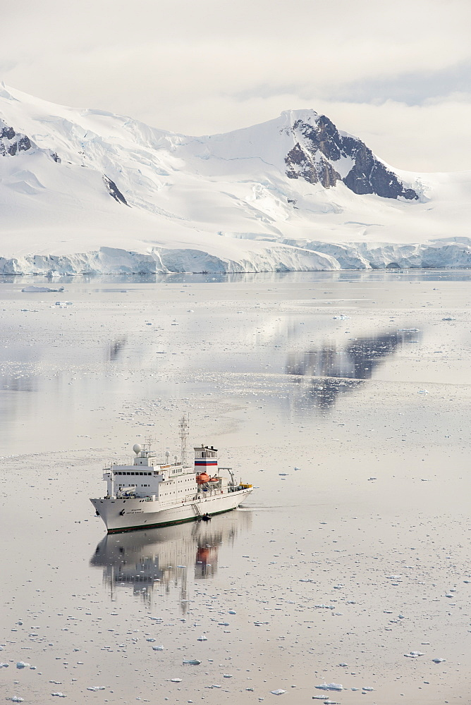 The Akademik Sergey Vavilov, an ice strengthened ship on an expedition cruise to Antarctica, in Paradise Bay in the Antarctic Peninsular, which is one of the fastest warming places on the planet.