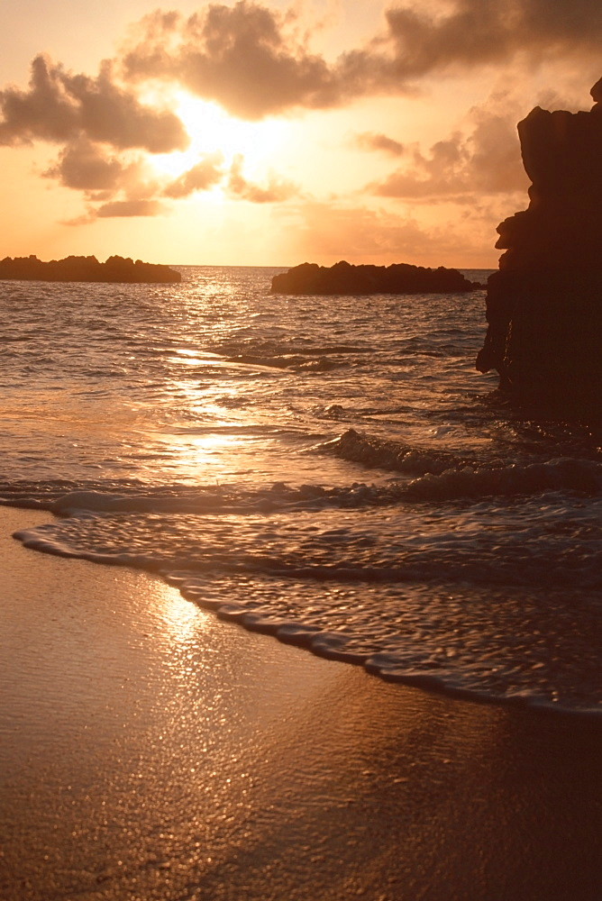 Waves and sunset at Waimea Bay, North Shore, Oahu, Hawaii, United States of America, Pacific
