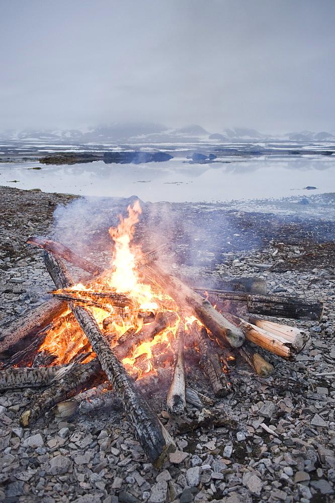 Bonfire on the beach. Svalbard, Norway