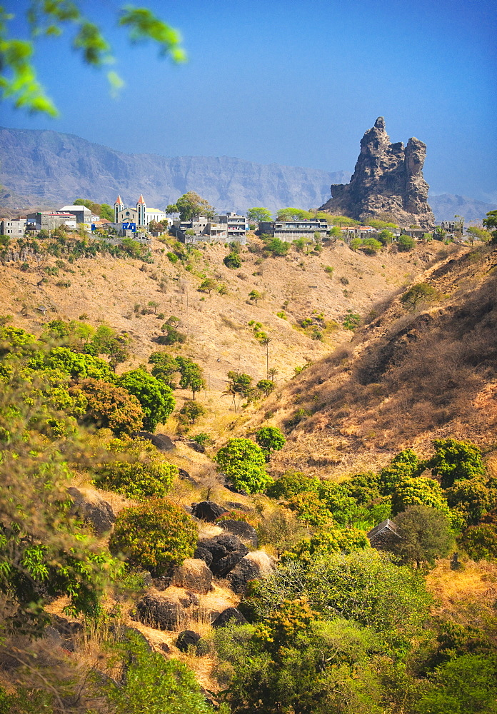 03/04/2009. The town of Picos on Sao Tiago Island of the Cape Verdes. Landscape view of volcanic formations and residential buildings with church. . Praia, Picos town, Sao Tiago Island. Cape Verde