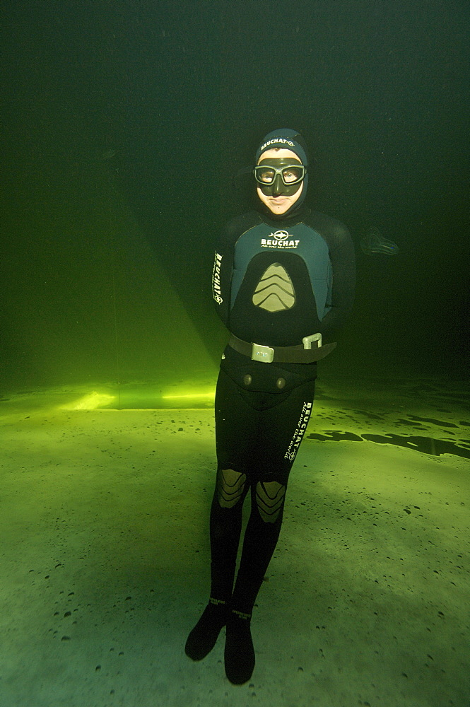 Freediving under the ice in Northern Russia in the White Sea. White Sea, Russia