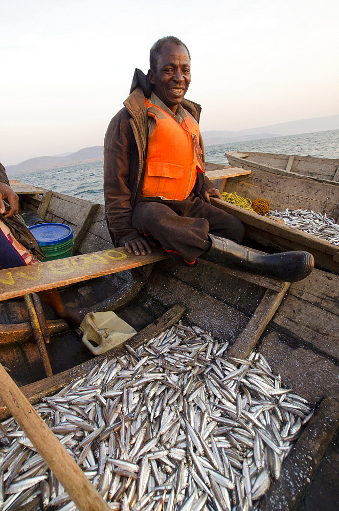 Fisherman on Lake Tanganyika early morning fishing for cichlids to sell in the local fish market, Zambia, Africa