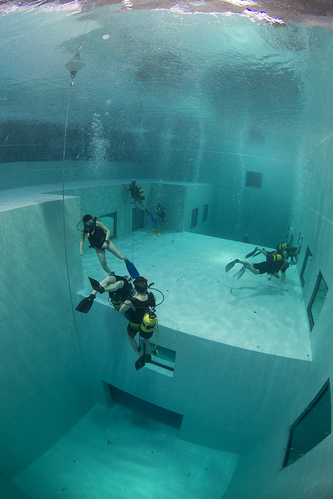 Divers in Nemon 33 pool, the deepest swimming pool in Europe, Belguim, Europe