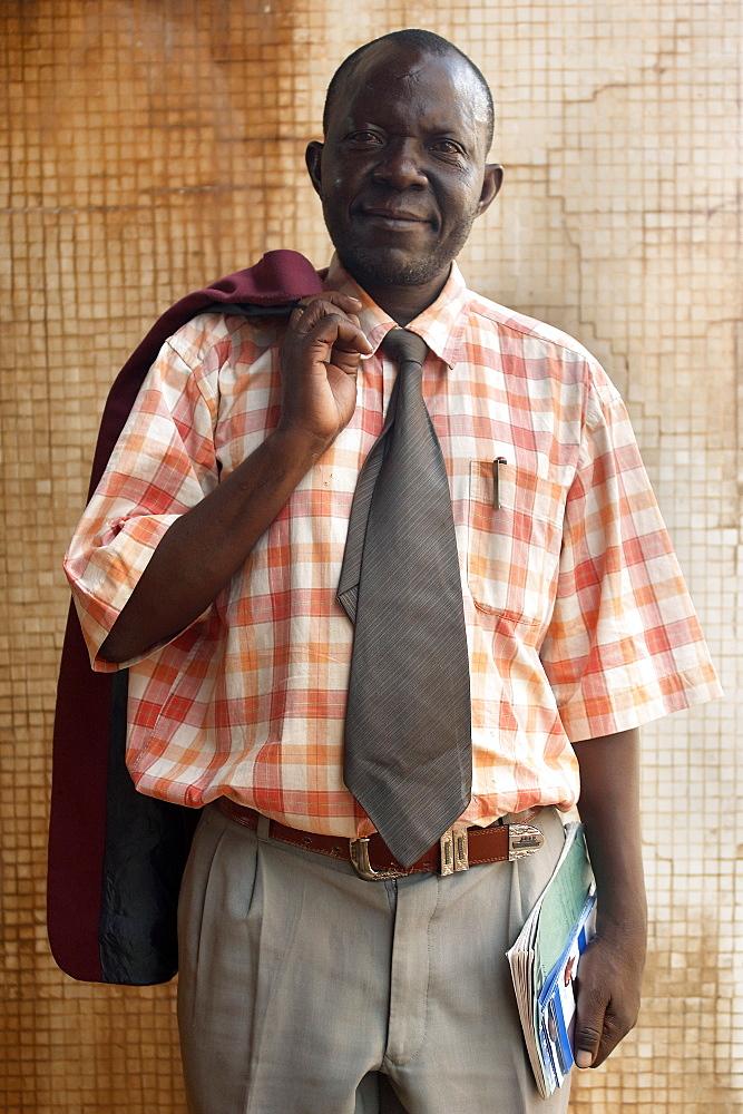 Portrait of an office worker in Downtown Kampala, Uganda. Kampala, Uganda, East Africa