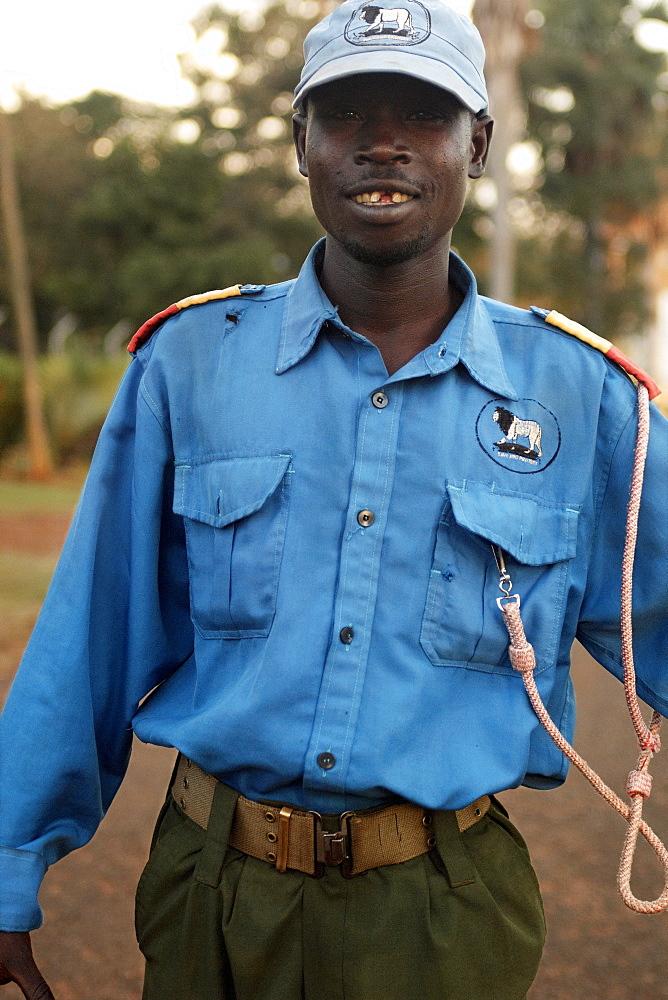 Security Guard patroling at sunset, Jinja. Uganda. Jinja, Uganda, East Africa