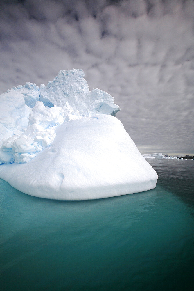 Iceberg detail in and around the Antarctic Peninsula during the summer months. More icebergs are being created as global warming is causing the breakup of major ice sheets.