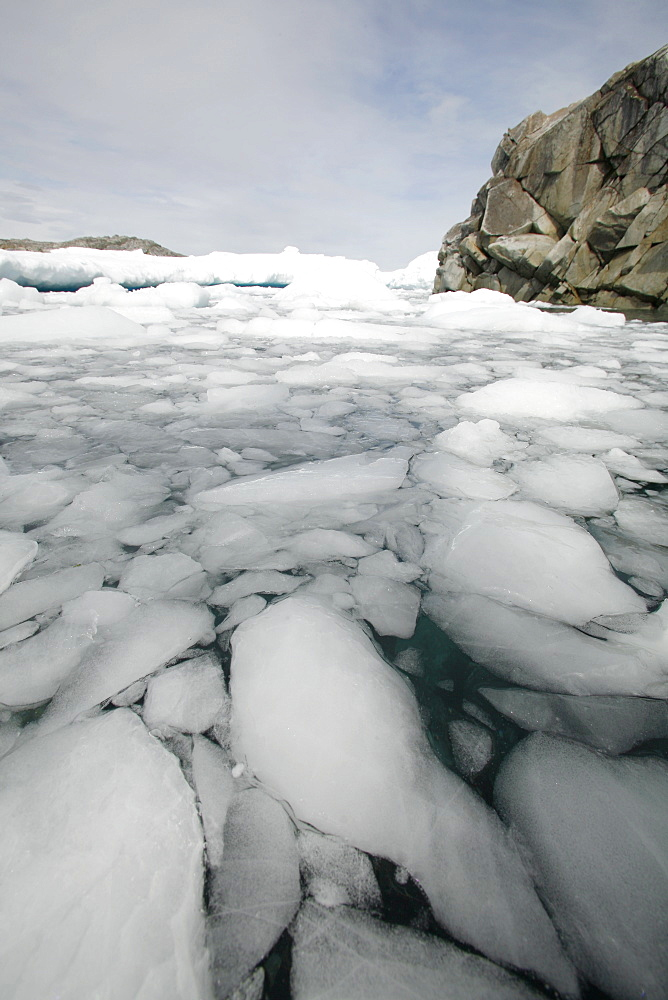A view of an ice-choked bay on Petermann Island near Lemaire Channel, Antarctica.