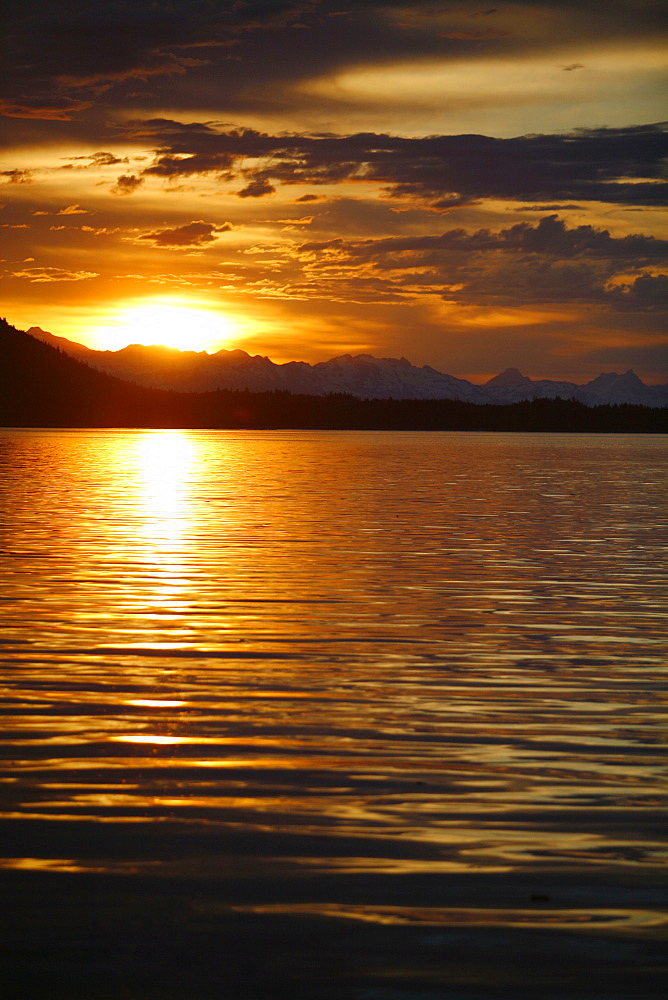 View of the shoreline at sunset from Colt Island in Stephen's Passage of Admiralty Island, Southeast Alaska, USA. Pacific Ocean.