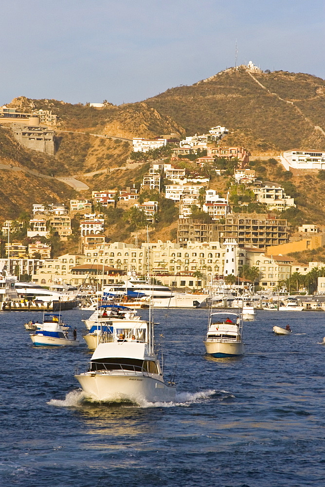 Tourism booms in Cabo San Lucas, Baja California Sur, Mexico. The Los Cabos area has grown to over 180,000 inhabitants (2007) in the last 10 years. Development is proceeding unchecked as the area struggles to provide fresh water for the new developments.