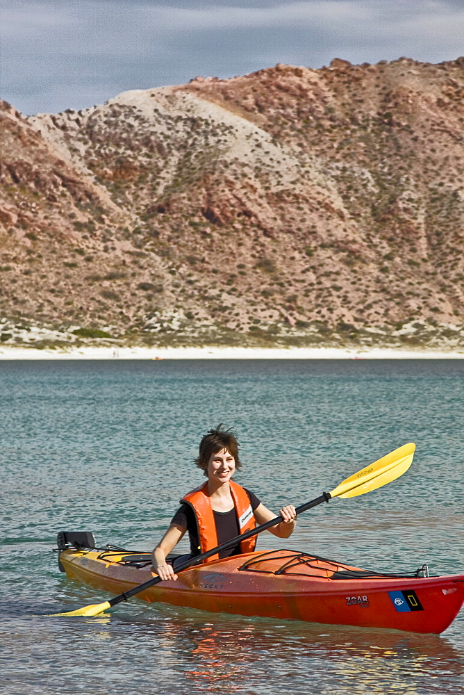 Lindblad Expeditions staff member kayaking on Isla San Francisco in the lower Gulf of California (Sea of Cortez), Baja California Norte, Mexico. Model Release #SD0408.