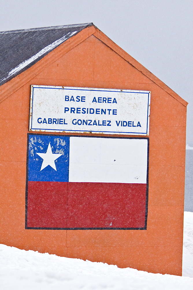 "Gabriel Gonz?lez Videla Base, on the Antarctic mainland's Paradise Bay, is named after Chilean President Gabriel Gonz?lez Videla, who in the 1940s became the first chief of state of any nation to visit Antarctica. The station was active from 1951-58, and was reopened briefly in the early 1980s and again in 2008. It is now a ""research"" base, with fuel and supplies in storage in the buildings for emergency use, staffed by 16 military personel in the summer months. Occasional summer visits are made by Chilean parties and tourists. On the north edge of the station there is a sign identifying Waterboat Point as an official historic site under the Antarctic Treaty. This was the place where the smallest ever wintering-over party (two men) spent a year and a day in 1921-1922. The two men, Thomas Bagshawe and M.C. Lester, had been part of the British Imperial Expedition, but their particular project, which involved flying a number of aircraft to the South Pole, was aborted. Nevertheless, they decided to stay over for the winter and made their shelter in an old whaling boat they found on this site. Their time was not wasted, however, because Bagshawe wrote the first scientific study of penguin breeding development. And today the gentoos, probably descendants of the ones he studied, nest in the ruins of the whaleboat shelter."