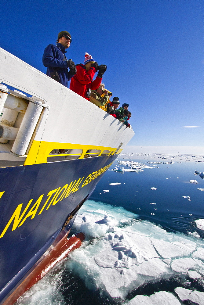 Guests from the Lindblad Expedition ship National Geographic Explorer in the Svalbard Archipelago, Norway