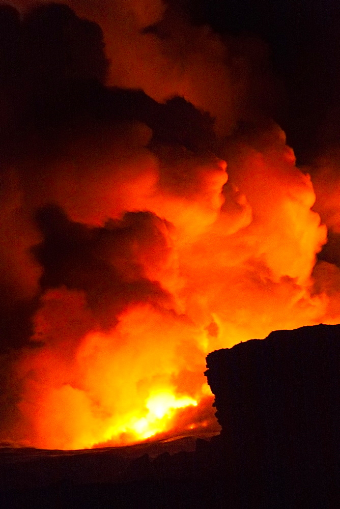 molten lava entering Pacific Ocean at Kalapana, creating hydromagnetic explosions and massive steam clouds, Puna, Big Island, Hawaii