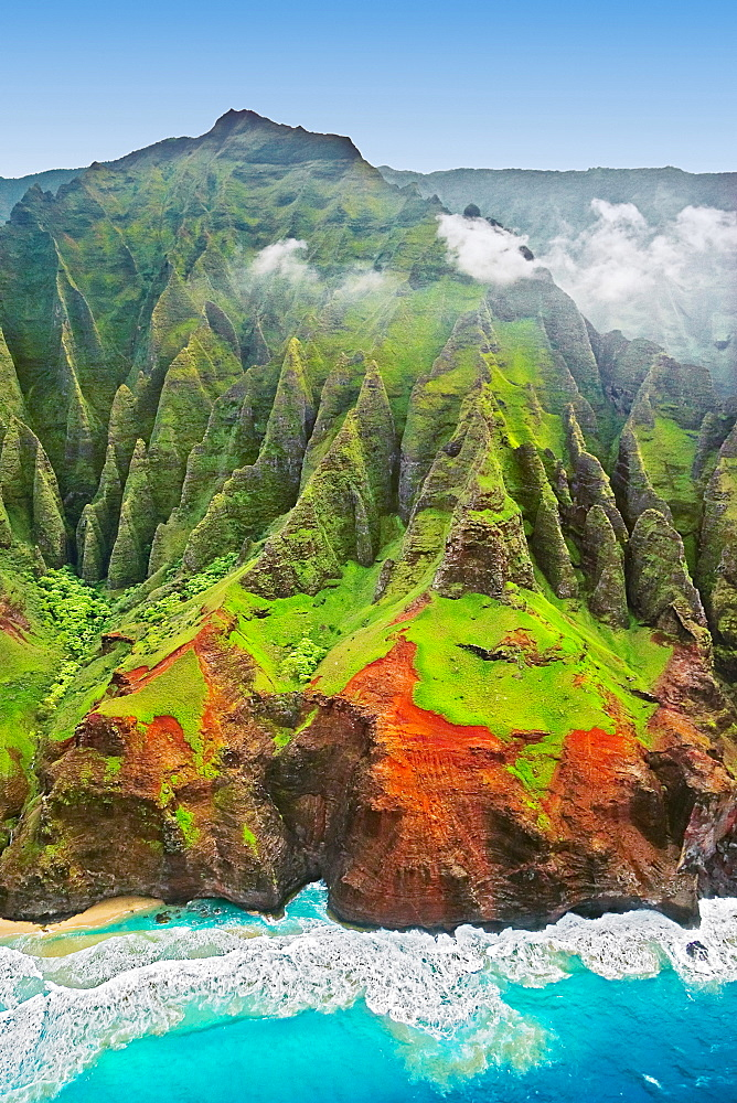 "sheer cliffs of Na Pali coast are sculpted by constant streams of water and rains, producing Kauai's famous ""red dirt"", Kauai, Hawaii, USA, Pacific Ocean"