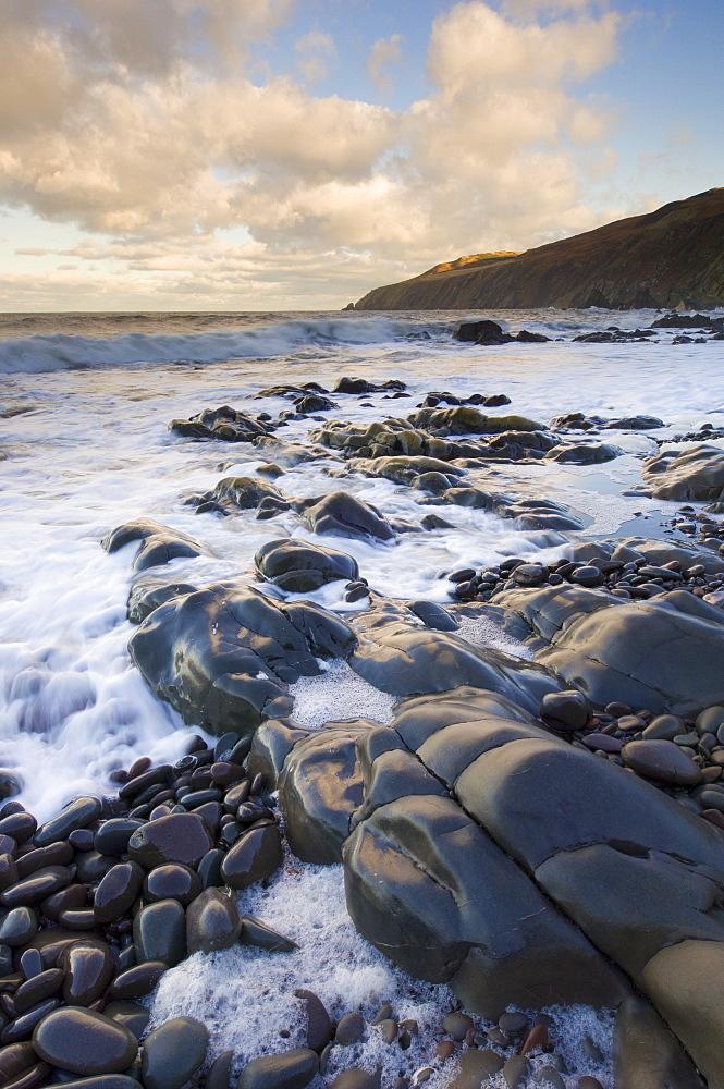 Rocky North Sea foreshore at dusk, Scottish borders, Scotland