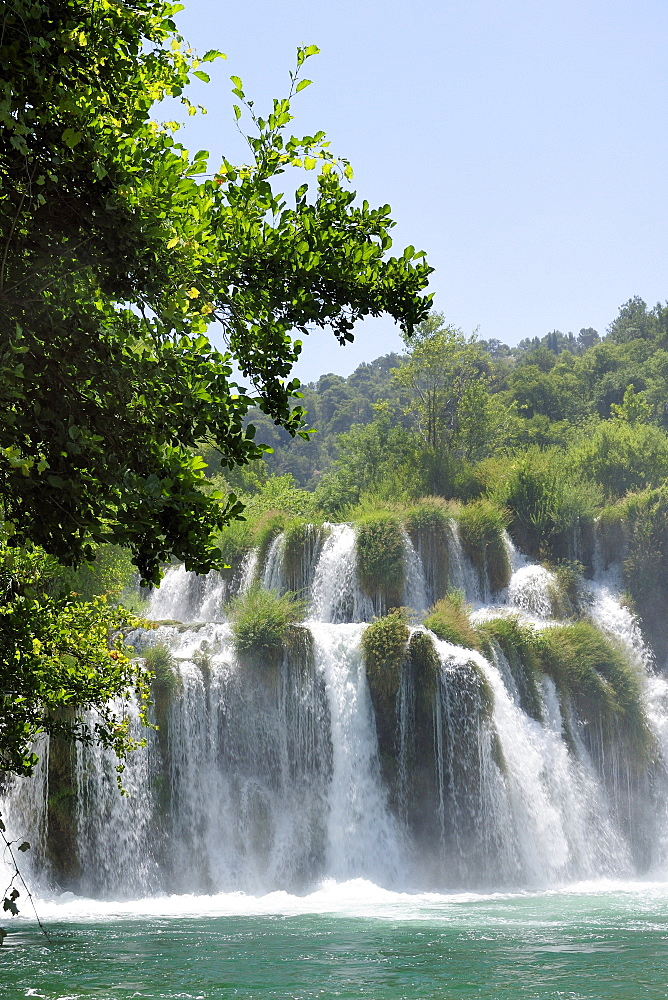Mist rising from Skradinski buk waterfalls with densely  forested surrounds, Krka National Park, Sibenik, Croatia, Europe