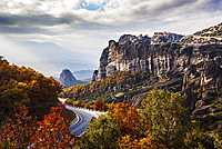 Monasteries Perched On Cliffs And A Winding Road In Autumn Foliage, Meteora, Greece