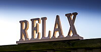 A sign saying 'Relax' in lettering, Hetton Hall, Northumberland, England