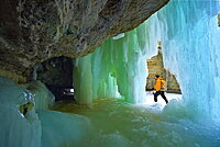 Exploring a canyon with frozen waterfall in winter, Jasper National Park, Alberta, Canada