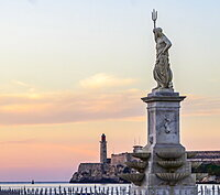Morro Castle at sunset, with a statue of Poseidon with trident in the foreground, Havana, Cuba