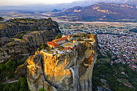 Aerial by drone of the Holy Monastery of Holy Trinity at sunrise, UNESCO World Heritage Site, Meteora Monasteries, Greece, Europe