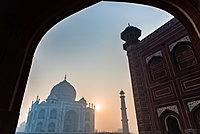 Sun rises behind the Taj Mahal. UNESCO World Heritage Site, Agra, Uttar Pradesh, India, Asia